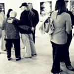 Visitors view an exhibition at the Arts Collective.